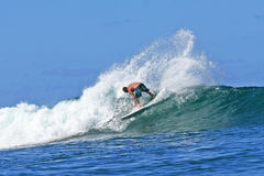 Pro Surfer Sunny Garcia surfing in Hawaii stock image