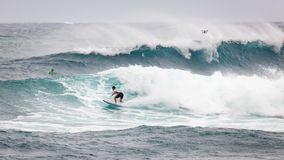 Pro Surfer Sunset Beach Hawaii. SUNSET BEACH, HAWAII, USA - DECEMBER 2: Surfer competing at the 2017 Vans World Cup of Surfing competition at Sunset Beach on Stock Image
