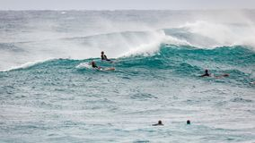 Pro Surfers Waiting for Waves. SUNSET BEACH, HAWAII, USA - DECEMBER 2: Surfers waiting for waves at the 2017 Vans World Cup of Surfing competition at Sunset Royalty Free Stock Photography