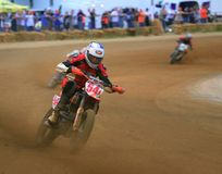 Pro track motorcycle race. Motorcycles fight for the lead on the race course at the professional motorcycle racing event on the dirt oval flat track speedway stock photo