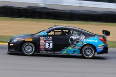 Pro voiture de course de Nissan Altima sur le cours Photo libre de droits