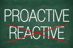 Proactive and Reactive handwritten Stock Image