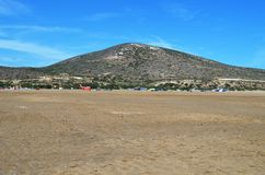 Probably the largest beach on Rhodes. Against the backdrop of a beautiful little mountain stock images