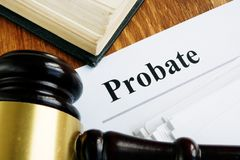 Probate sign, stack of papers.