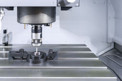 The probe for measurement on the CNC machine Stock Photos