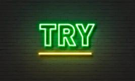 Probeer neonteken op bakstenen muurachtergrond Stock Fotografie