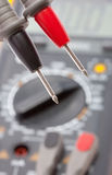 Probes against digital multimeter Royalty Free Stock Image