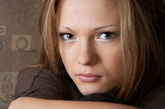 Probing glance. Young beautiful woman with probing, slightly sad glance Royalty Free Stock Photography