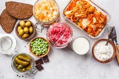 Probiotics food concept. Kimchi, beet sauerkraut, sauerkraut, cottage cheese, peas, olives, bread, chocolate, kefir and pickled. Probiotics food background royalty free stock photography