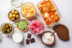 Probiotics food concept. Kimchi, beet sauerkraut, sauerkraut, cottage cheese, peas, olives, bread, chocolate, kefir and pickled. Probiotics food background stock photography