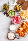 Probiotics food concept. Kimchi, beet sauerkraut, sauerkraut, cottage cheese, peas, olives, bread, chocolate, kefir and pickled. Probiotics food background royalty free stock image