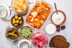 Probiotics food concept. Kimchi, beet sauerkraut, sauerkraut, cottage cheese, peas, olives, bread, chocolate, kefir and pickled. Probiotics food background royalty free stock photo