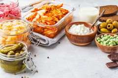 Probiotics food concept. Kimchi, beet sauerkraut, sauerkraut, cottage cheese, peas, olives, bread, chocolate, kefir and pickled. Probiotics food background stock photo