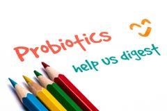 Probiotics help us digest. Handwritten on paper Royalty Free Stock Photography