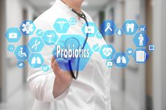 Probiotics on the touch screen with icons on the medicine backgr Royalty Free Stock Photography
