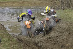 Problem. Motorcycle race on a cross-country terrain Stock Image