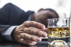 Problem With Alcohol. Drunk man with problems with head on laptop stock photo