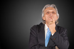 Problem. Business man has a problem and black background Stock Image