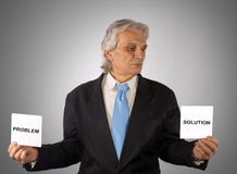 Problem. Business man holding a paper on silver background Stock Photography