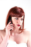 Problem call. A woman wrapped in a towel taking a telephone call Stock Photo