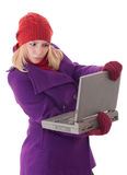 Problem with computer. Young blond female having trouble with a laptop isolated on white background stock photos