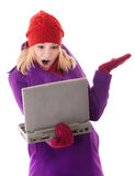 Problem with computer. Young blond female having trouble with a laptop isolated on white background royalty free stock image