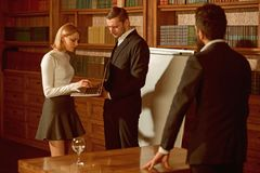 Problem concept. Business people work on problem solution. Woman and men discuss problem in university library. Problem. Solving and making decision together stock image
