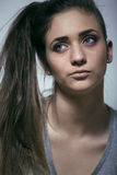 Problem depressioned teenage with messed hair and sad face, real junky bad looking girl close up Royalty Free Stock Images