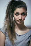 Problem depressioned teenage with messed hair and sad face, real junky bad looking girl close up Royalty Free Stock Photography
