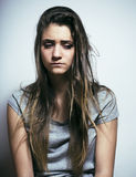 Problem depressioned teenage with messed hair and sad face, real junky bad looking girl close up Royalty Free Stock Image