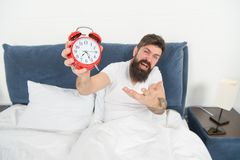 Problem with early morning awakening. Get up with alarm clock. Overslept again. Tips for waking up early. Tips for royalty free stock photos