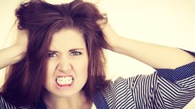 Attractive woman having angry frustrated face expression. Problem expressions concept. Irritable attractive woman having angry wrathful frustrated face Stock Image