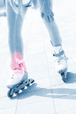 Problem with foot while roller blading Stock Photo