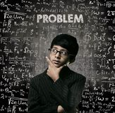 Problem. Genius Little Boy Thinking Wearing Glasses Chalkboard Royalty Free Stock Image