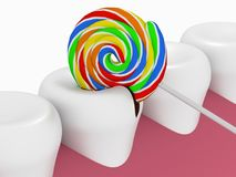 A lollipop destroys a tooth on white background. Problem of hygiene of the oral cavity, harm of sweet and caries Stock Photo