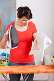 Problem with iron. Young housewife has a problem with iron Royalty Free Stock Photos