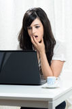 Problem with laptop. Worried woman watching the screen of her laptop Stock Images