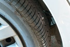 Punctured tire by bolt. The problem with punctured tire by bolt royalty free stock image