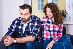 Problem in relationship - unhappy man with girlfriend Stock Images