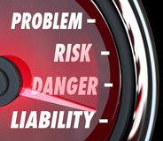Problem Risk Danger Liability Speedometer Gauge Measure Exposure. Problem, Risk, Danger and Liability words on a speedometer or gauge to measure your legal Royalty Free Stock Photos