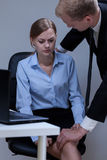 Problem of sexual harassment at work Royalty Free Stock Photography
