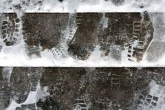 The problem of snow removal in the city. The steps are icy, covered with snow. footprints in the snow. Winter, heavy snow royalty free stock images