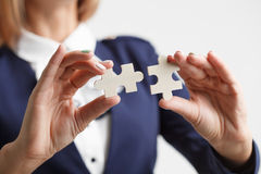 Problem solution concept flat.Man`s hand places last detail of puzzle in jigsaw Royalty Free Stock Image