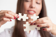 Problem solution concept flat.Man`s hand places last detail of puzzle in jigsaw. Concept: diversity, team work and access solutio Royalty Free Stock Image