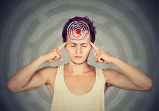Problem solution concept. Young puzzled man Royalty Free Stock Images