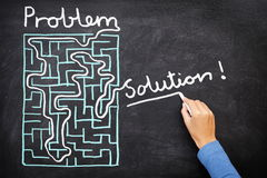 Problem and solution - solving maze. Problem and solution - person solving maze. Blackboard / chalkboard business concept royalty free stock photos