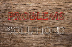Problem and Solution written on wooden background Stock Photos