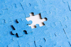 Problem solved concept - placing last piece of puzzle Stock Photography