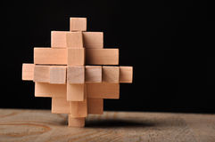 Problem solved, wooden puzzle. Wooden puzzle on black background Royalty Free Stock Photo
