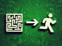 Problem solving. Stylized running human silhouette, which is leaving the exit of a labyrinth, representing concepts such as problem solving, success, and action Stock Image